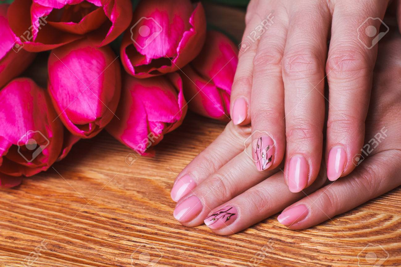 Pink Nail Art With Flowers On Wood Background Stock Photo Picture