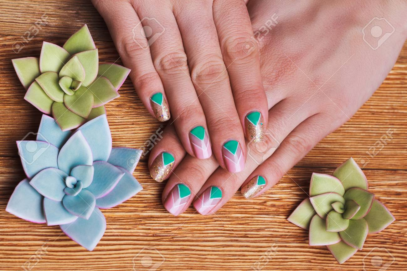 Nail Art With Bright Gold Pink And Green Chevron Pattern On Stock