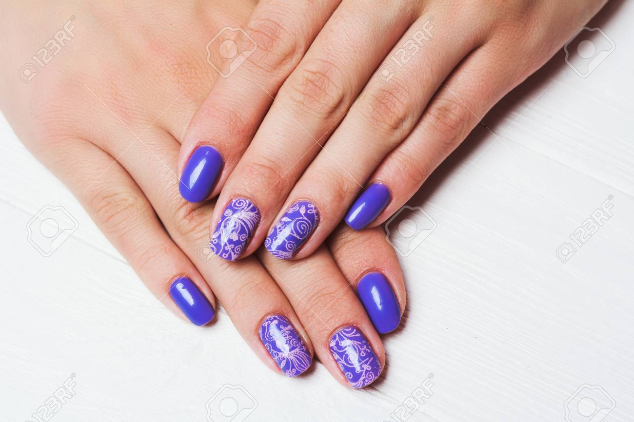 Purple Nail Art With Pink Floral Pattern On White Wooden Background ...