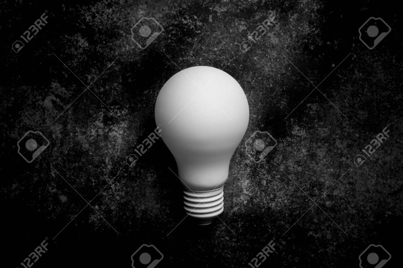 White Light Bulb On On Dark Background Monochrome Stock Photo Picture And Royalty Free Image Image 123553281