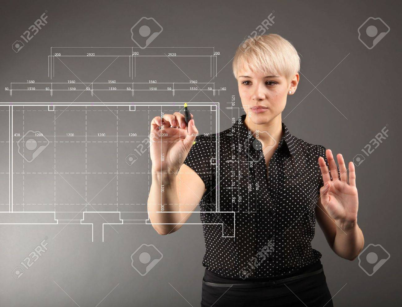 Blueprint design technical concept - girl drawing on screen Stock Photo - 12053208