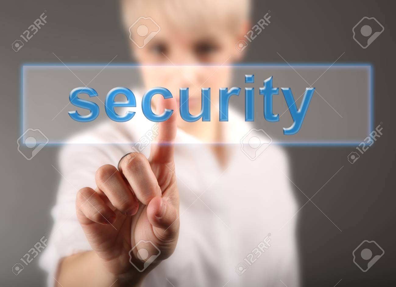 Security concept - business woman and word button Stock Photo - 17394719