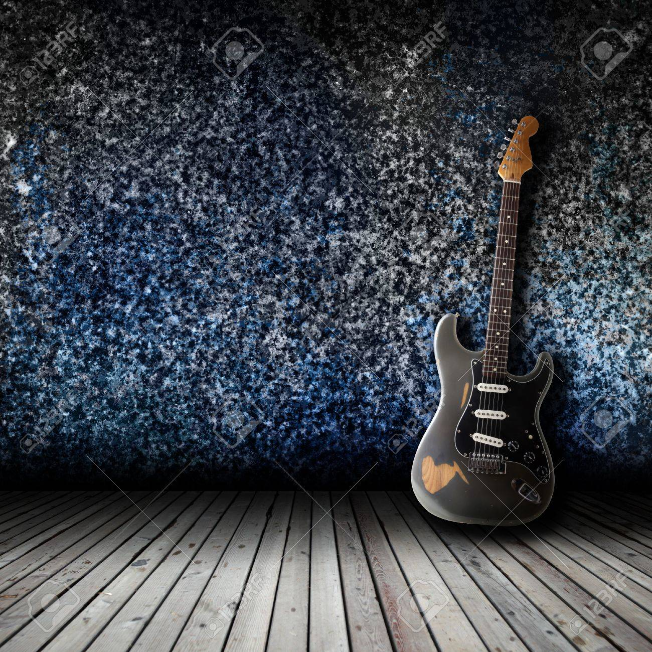Electric guitar in the empty room concept Stock Photo - 18534132