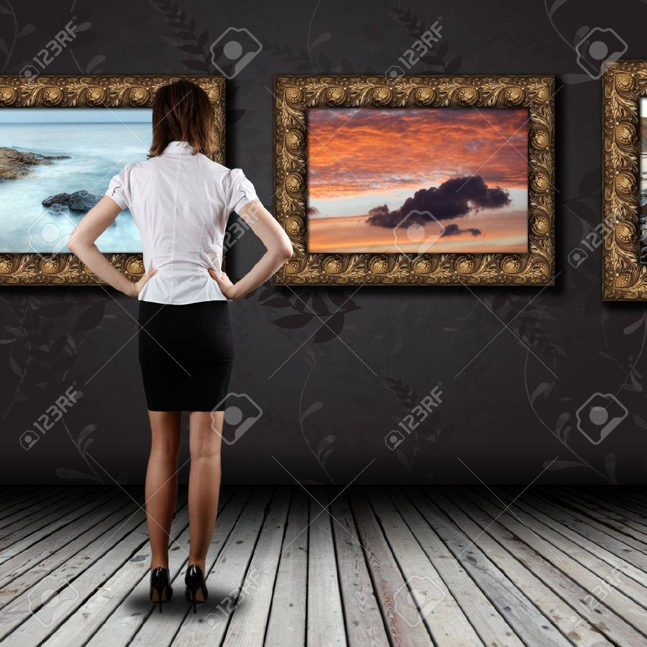 Woman standing in the gallery and watching art - 20014271