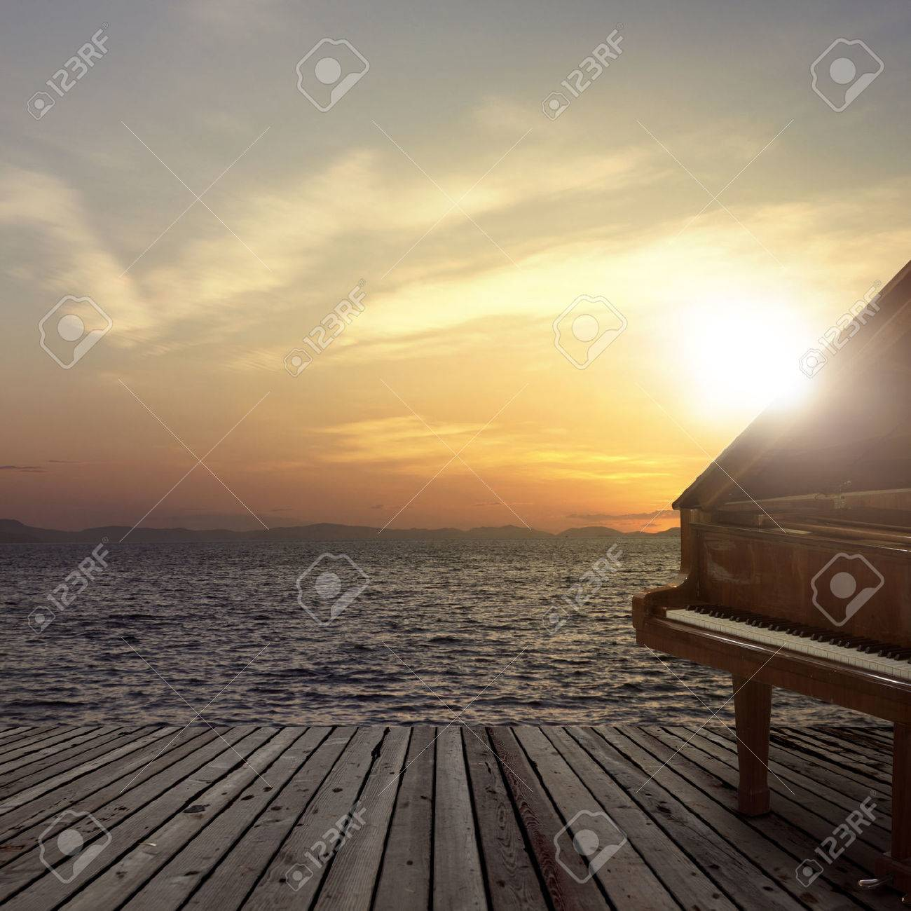 Piano outside shot at sea side during sunset - 63675098
