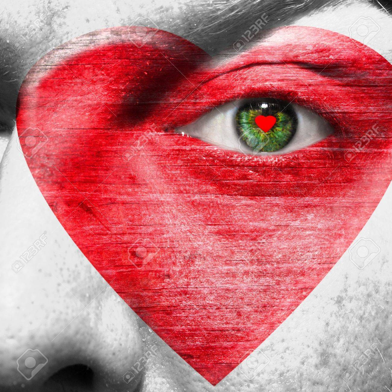 Red Heart Painted On White Face With Heart Shaped Red Pupil In