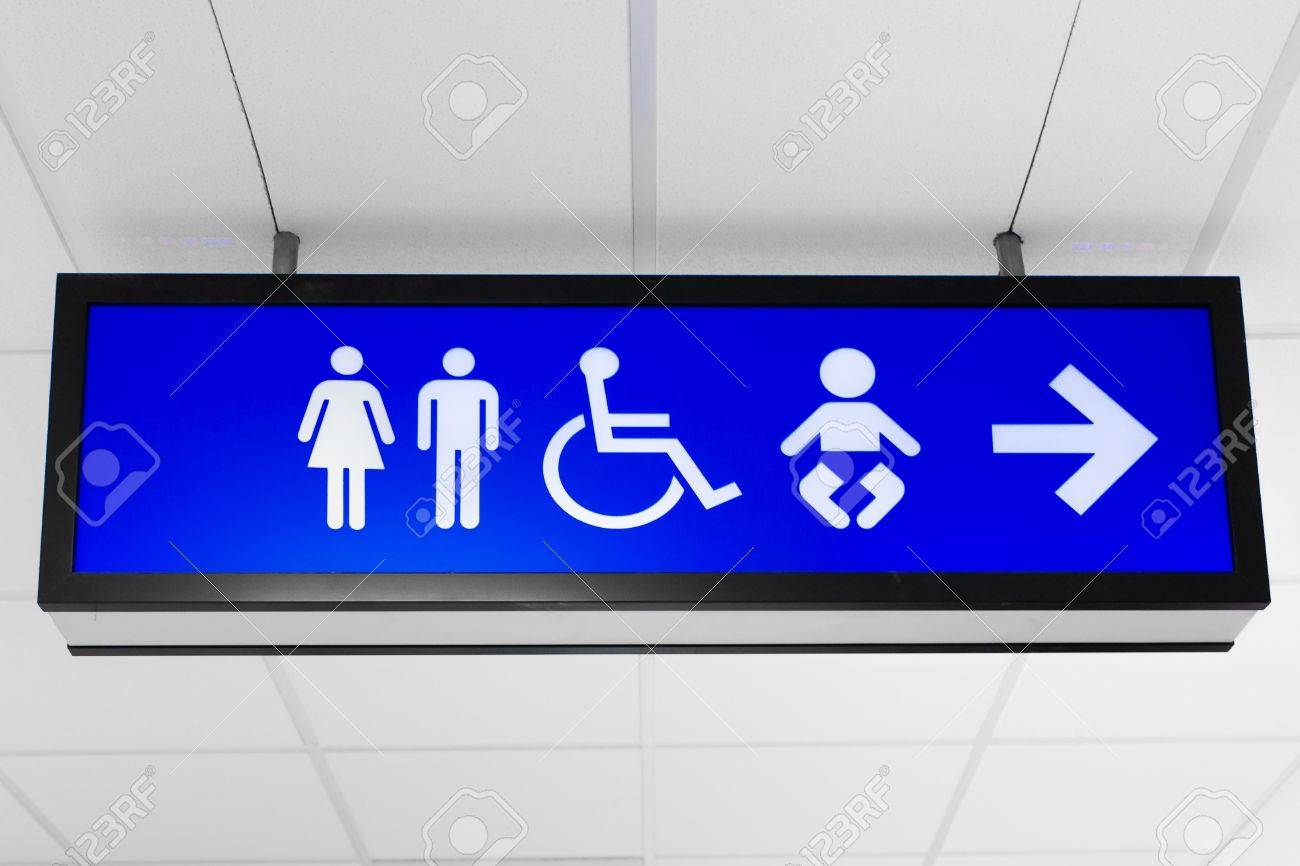 Blue Public Sign Showing Toilet And Baby Change Room Directions Stock Photo