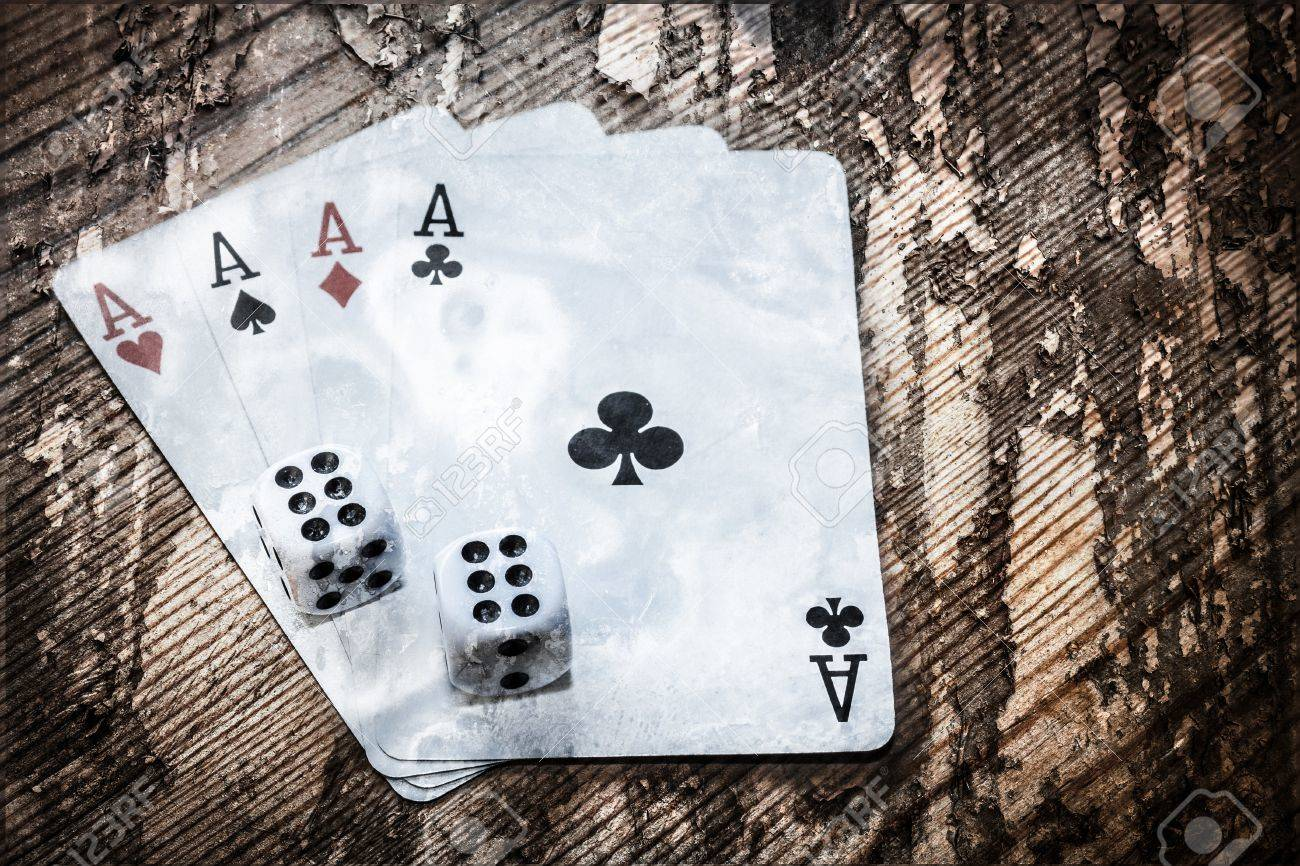 Four aces cards and double six dice Stock Photo - 24997690