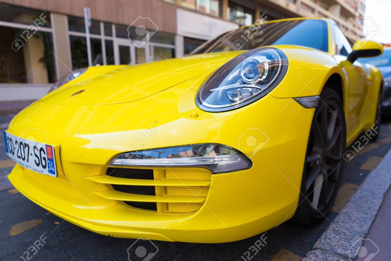 TOULOUSE, FRANCE , JULY 22, 2014 Parked bright yellow Porsche..
