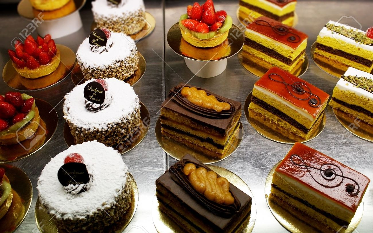 A variety of Italian decorated pastries, cakes and slices of..