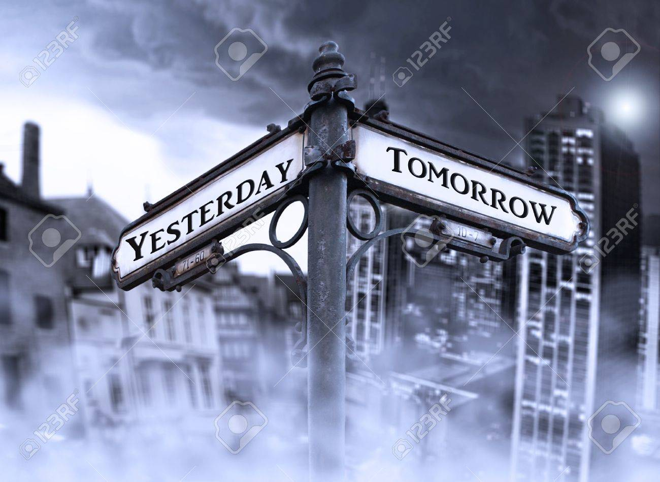 Arrows indicates Yersterday and Tomorrow with two different dramatic view: old and new city wrapped in fog in the background Stock Photo - 12044361