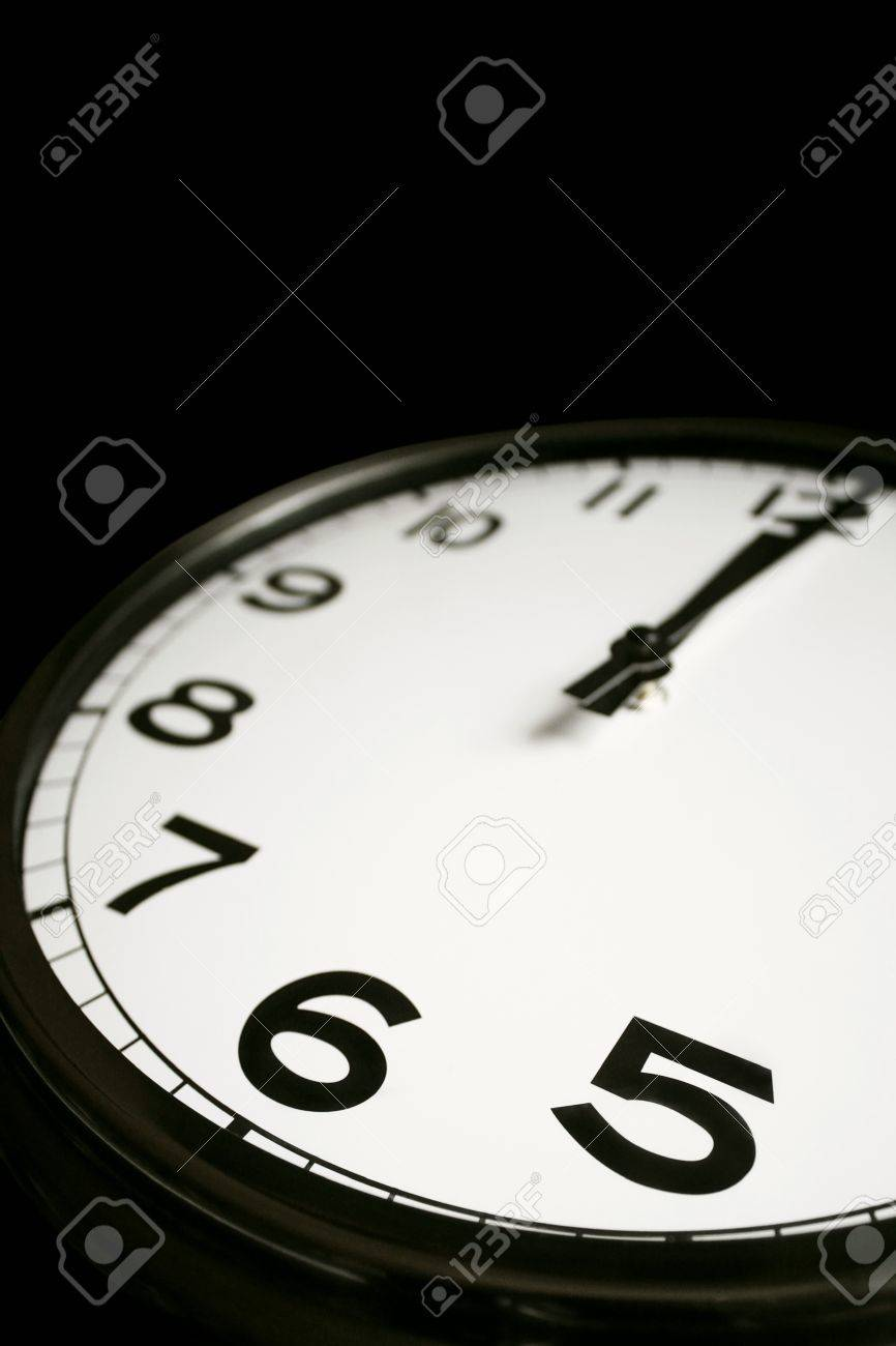 Detail of a clock on the black background Stock Photo - 12177576