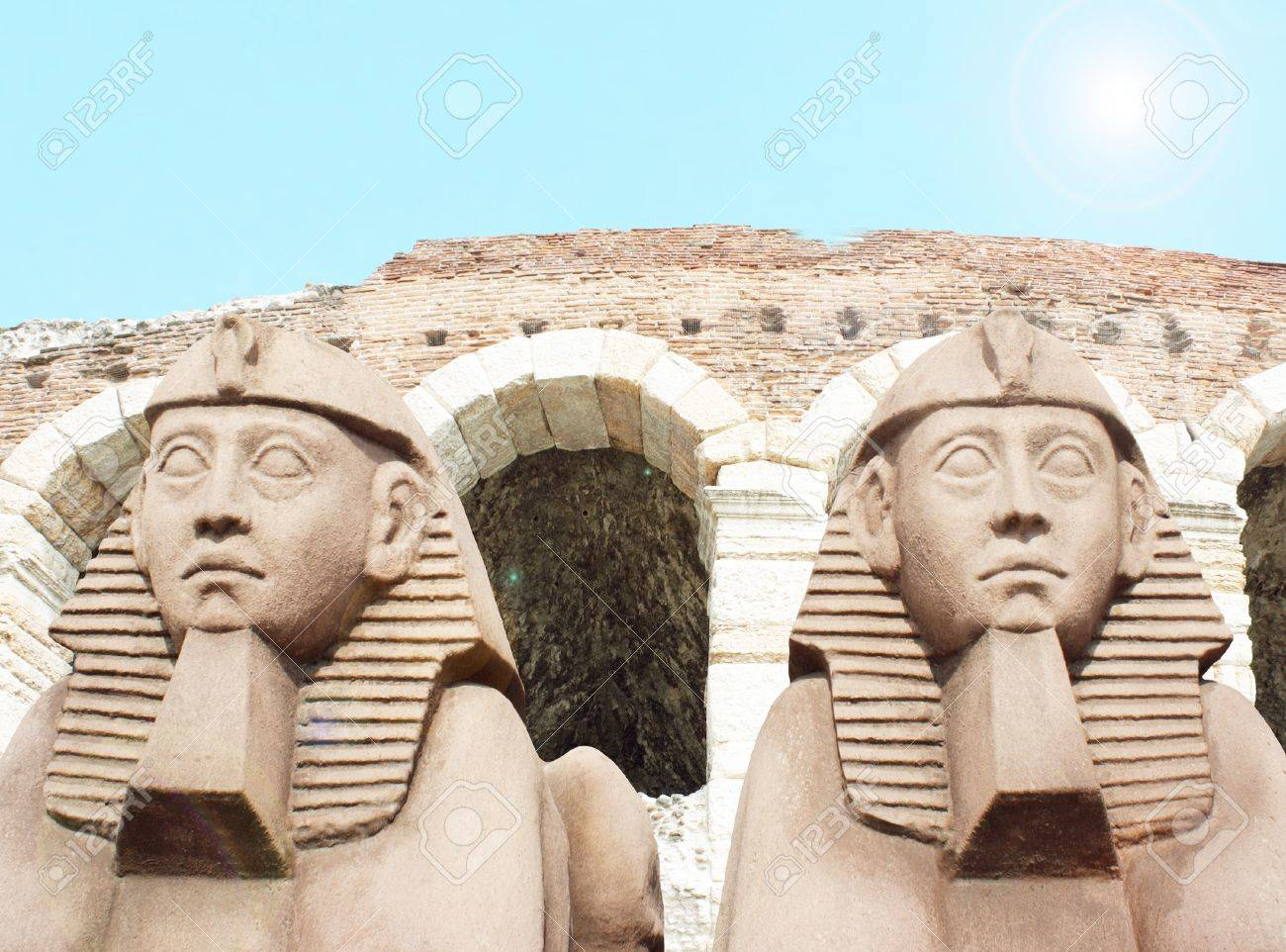 Detail of two sphinxes with the arena Verona and blue light sky on the background Stock Photo - 14185003