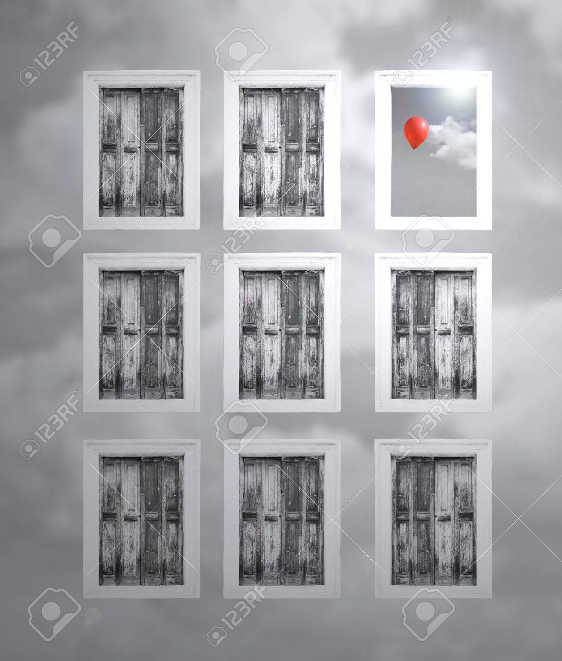 Fantasy shutters in a cloudy wall and one opened window with cloud and red balloon in black and white - 14274849