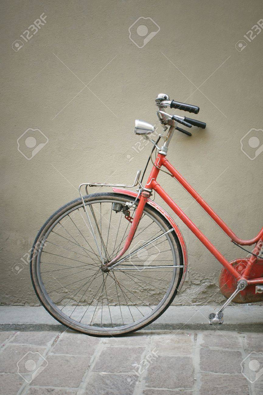 Detail of a red vintage bicycle leaning against a wall Stock Photo - 14442496