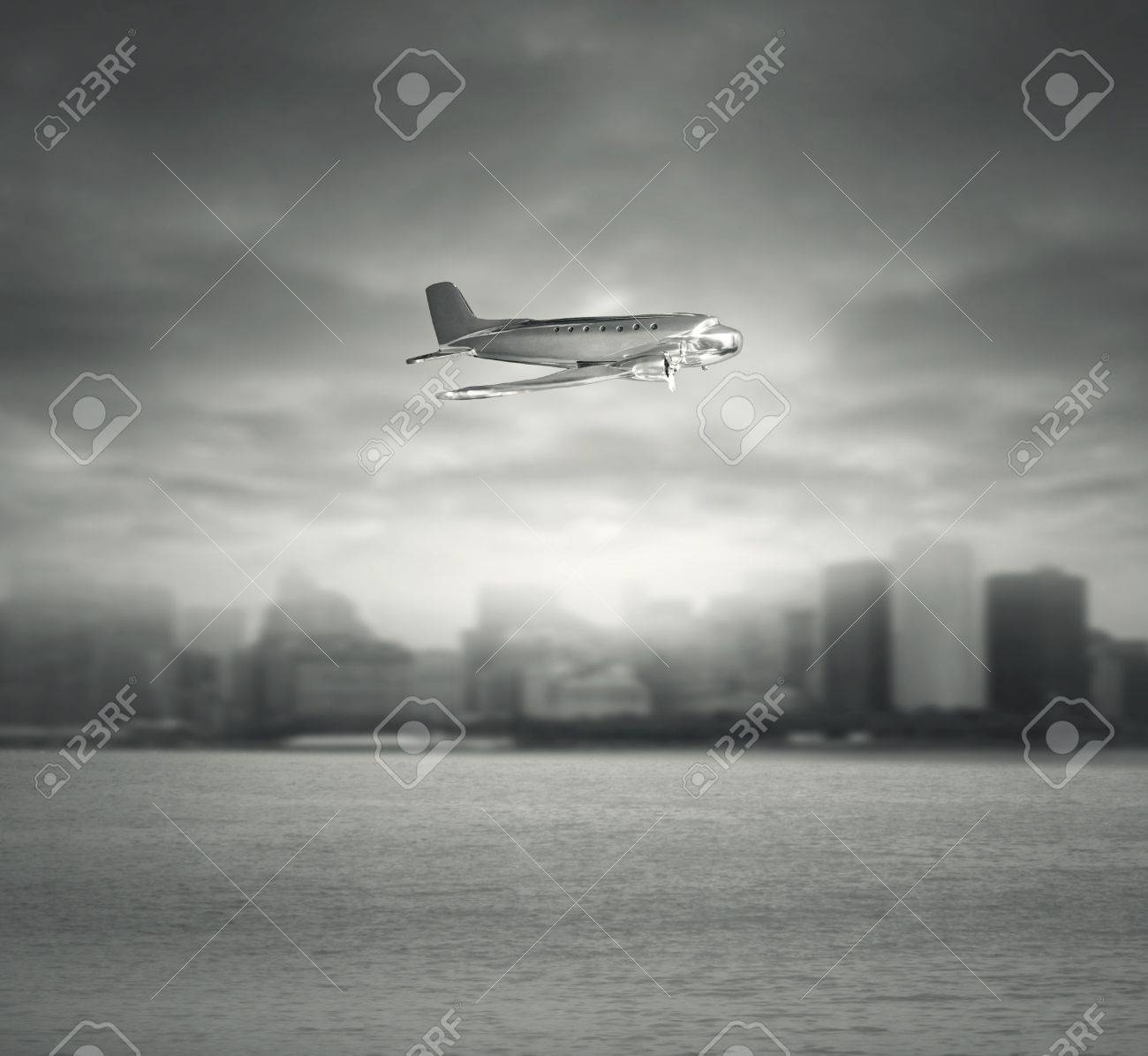 Artistic Composition Of A Vintage Airplane Toy In Flight Under The Sea With City And