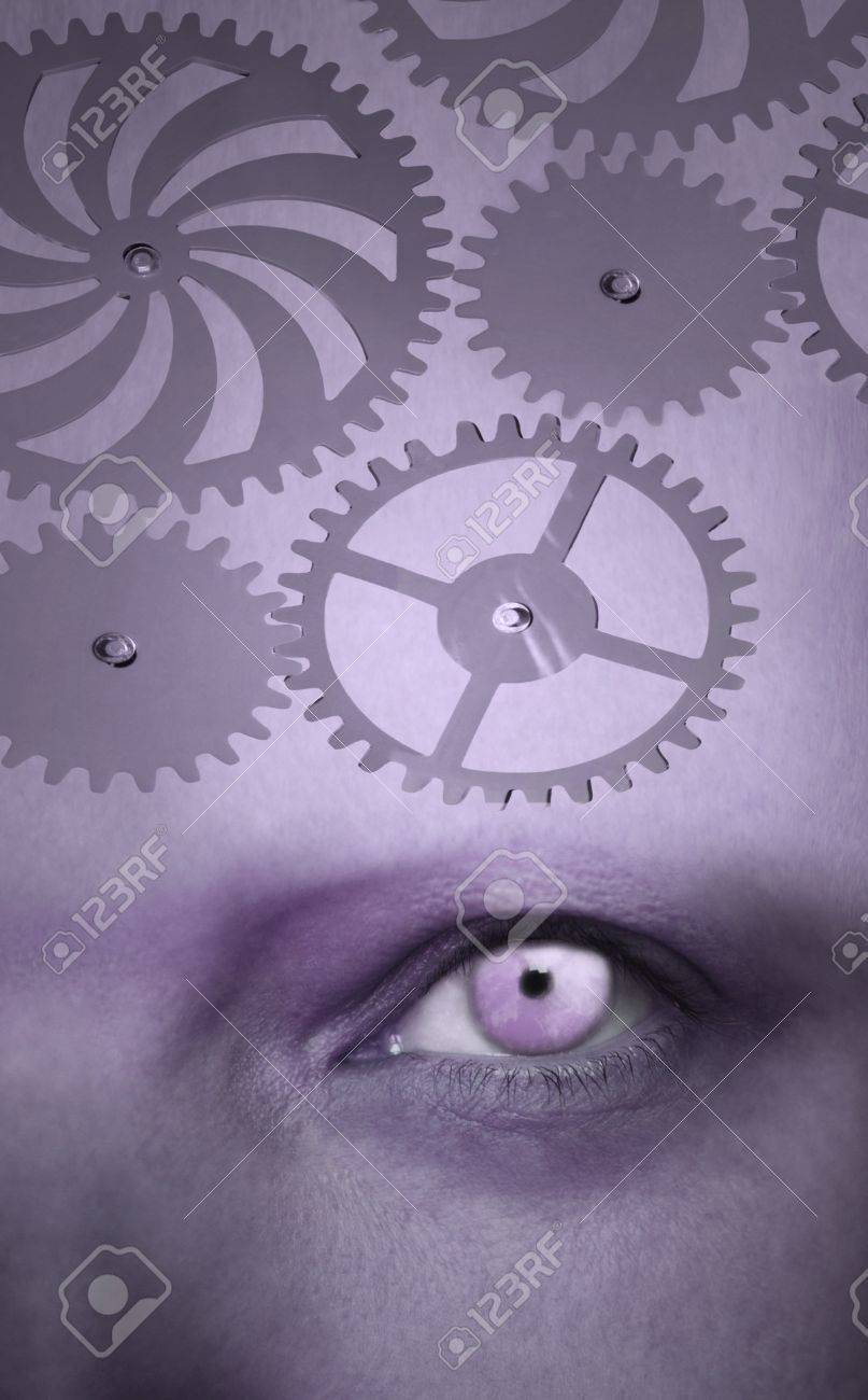 One human eye with gear on the forehead in purple color Stock Photo - 18792009