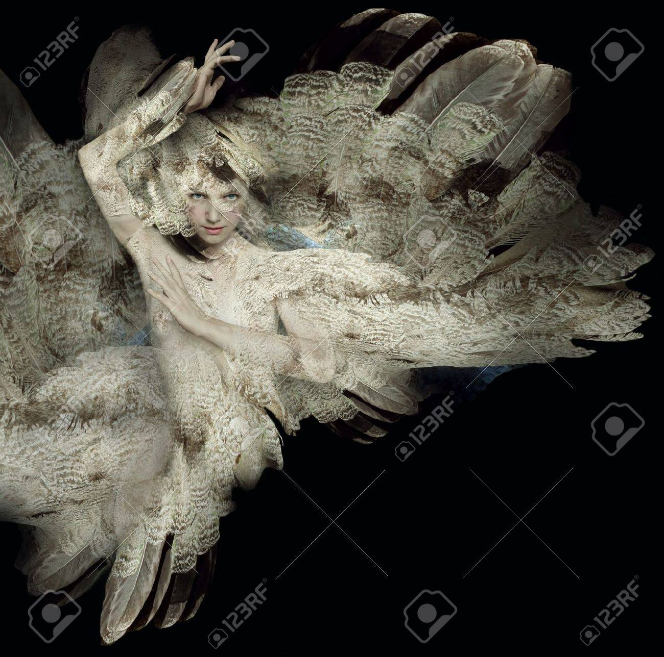 Beautiful artistic portrait of a girl with plumage on black background - 21421073