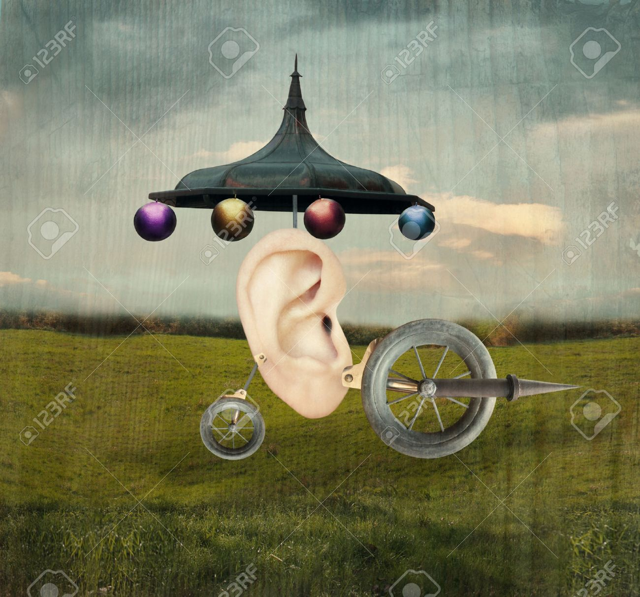 Beautiful artistic image that represent a human ear with surreal wheels and mechanic object in a surreal Stock Photo - 22837331