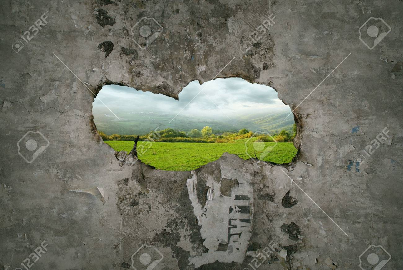 Beautiful fantasy imagine representing a hole crack in a old wall with a view of a landscape through it - 24058094