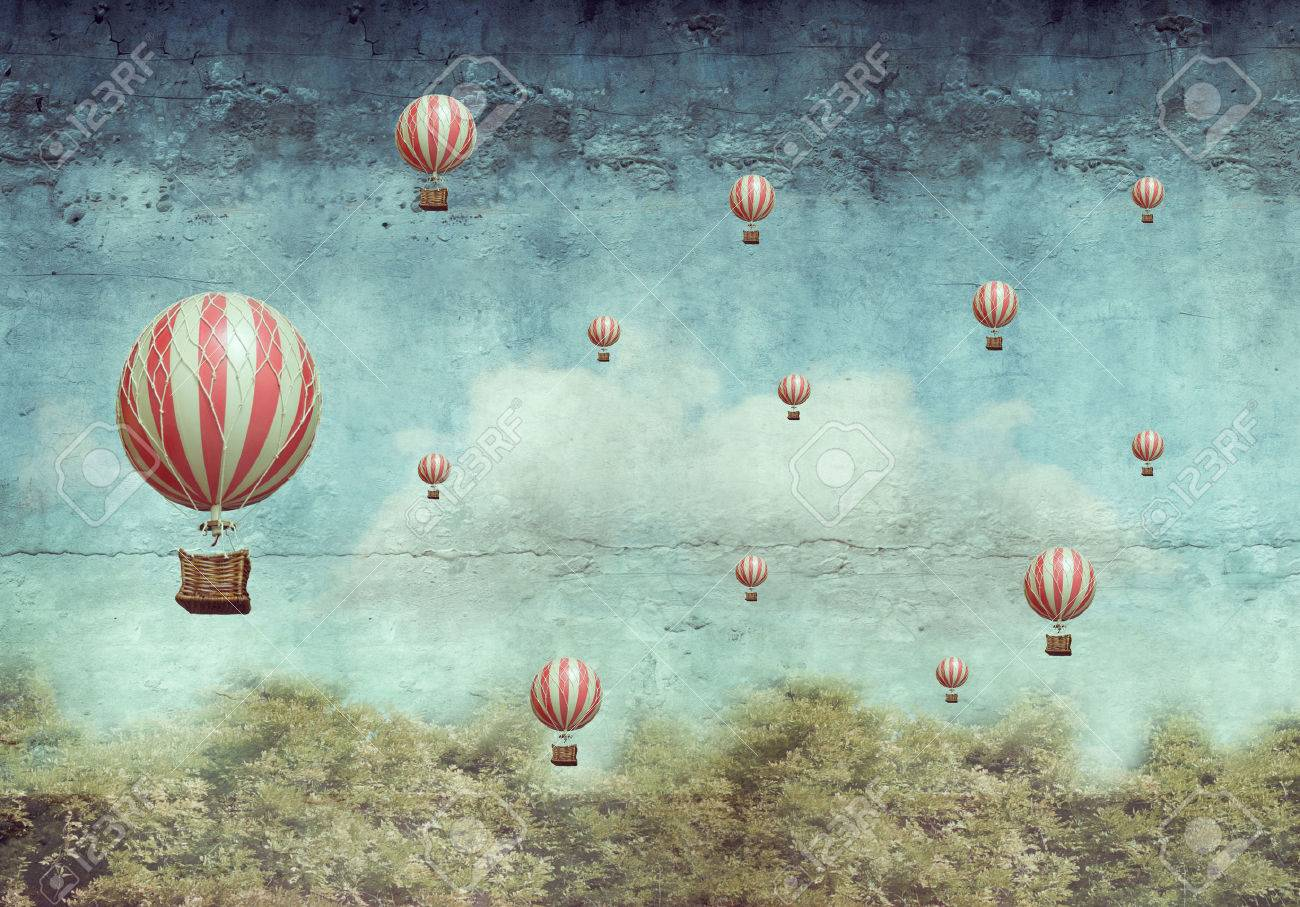 Many hot air balloons flying over a forest - 38210034