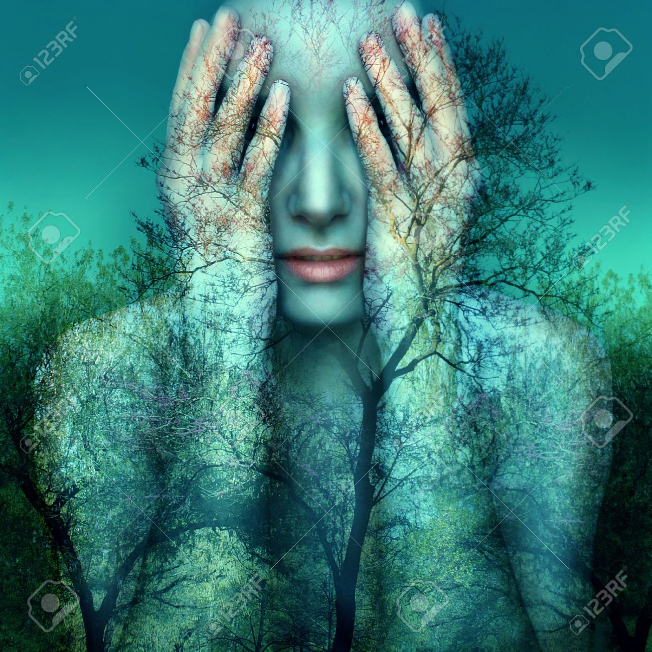 Surreal and artistic image of a girl who covers her eyes with her hands on a background of trees and sky - 53633006