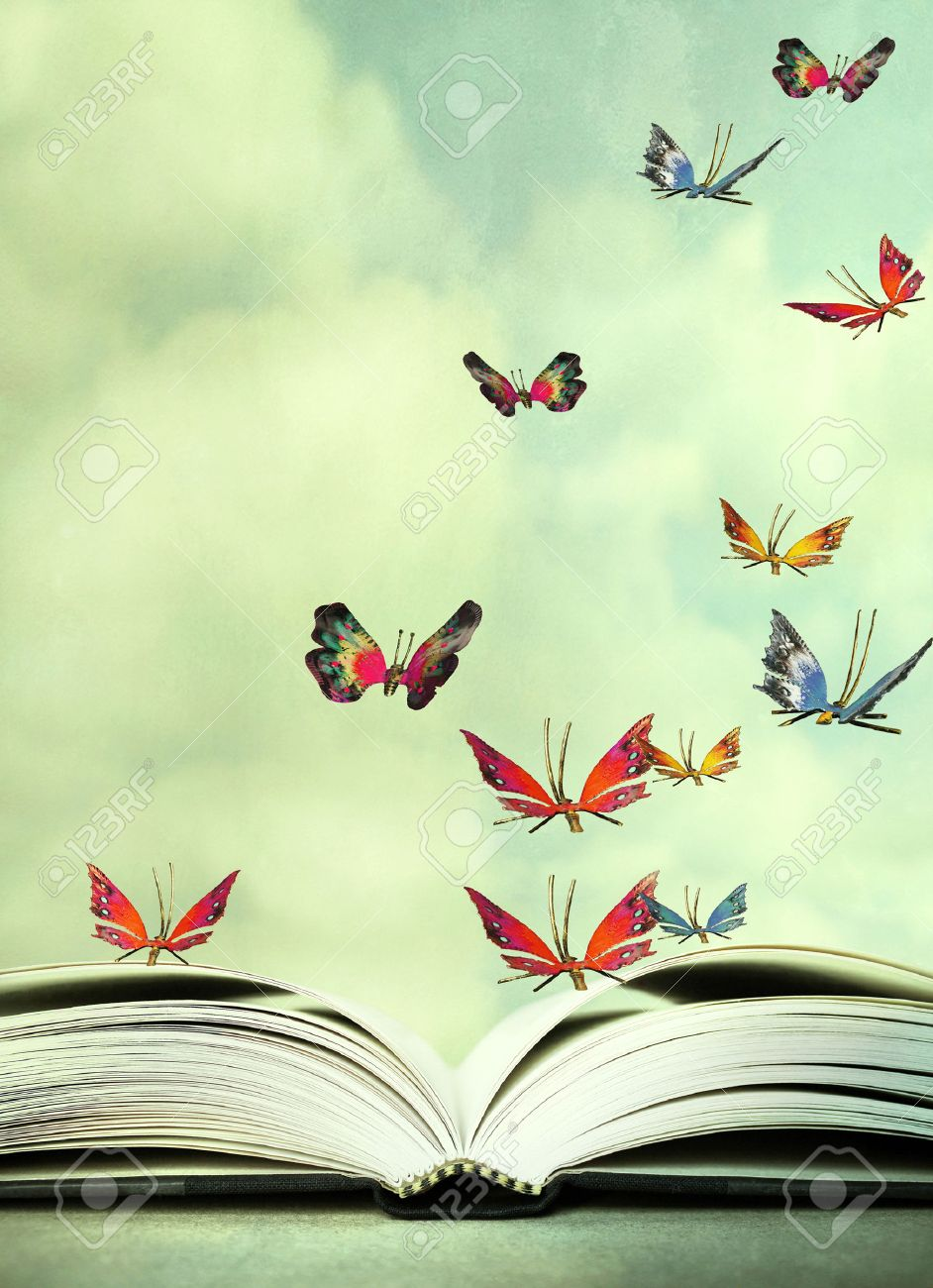 Artistic image of an open book and colorful butterflies that hover in the sky - 59790365