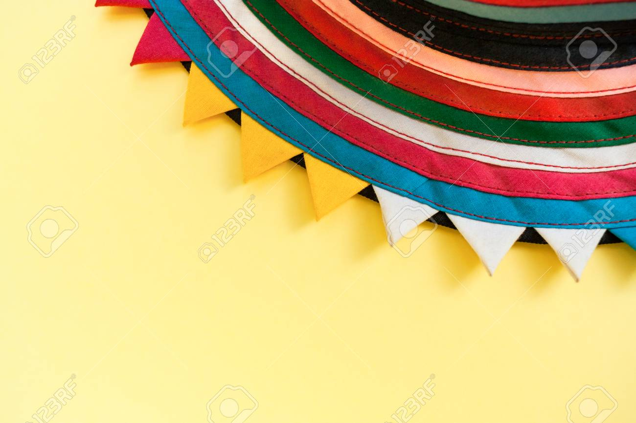 Semicircular Handmade Cloth Of Stitched From Colorful Stripes On Top Bright Pastel Yellow Background With