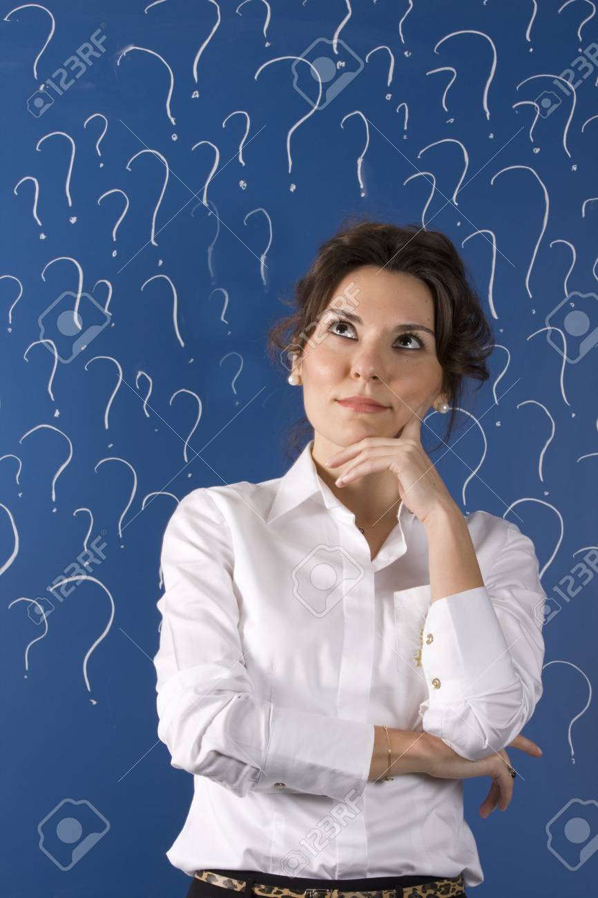 thinking business woman in front of question marks written blackboard Stock Photo - 11310695