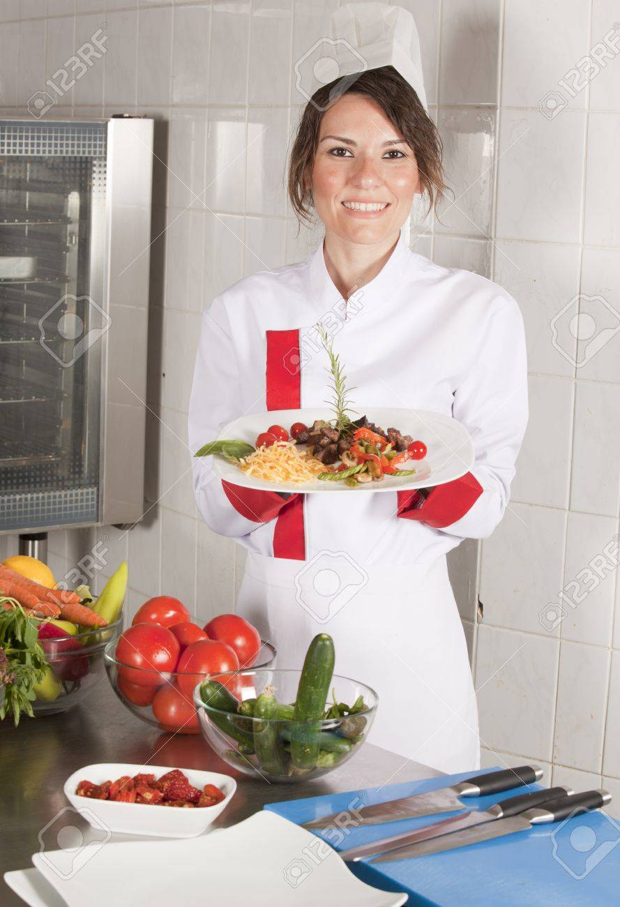 portrait of mid adult female chef in kitchen Stock Photo - 14758529