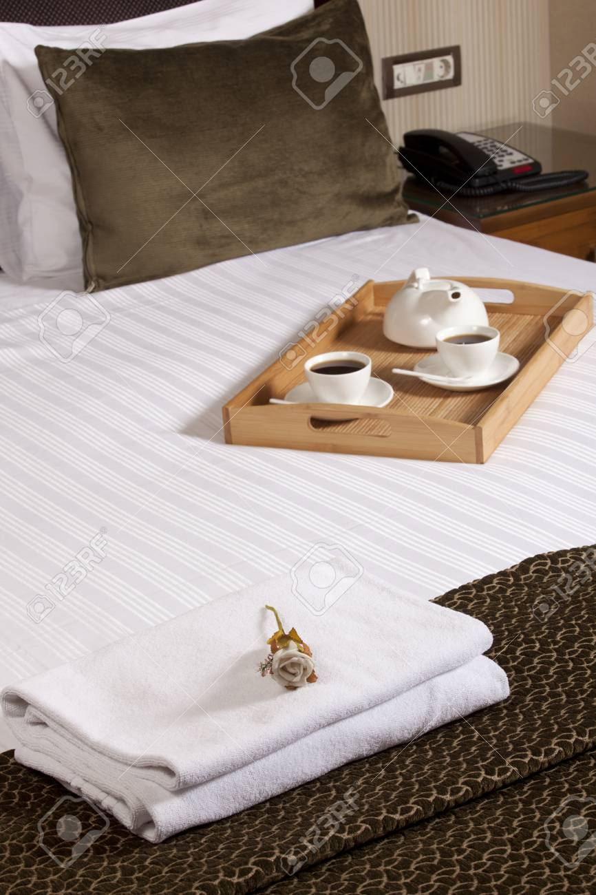 Tray with coffee on a bed in a hotel room Stock Photo - 16198360