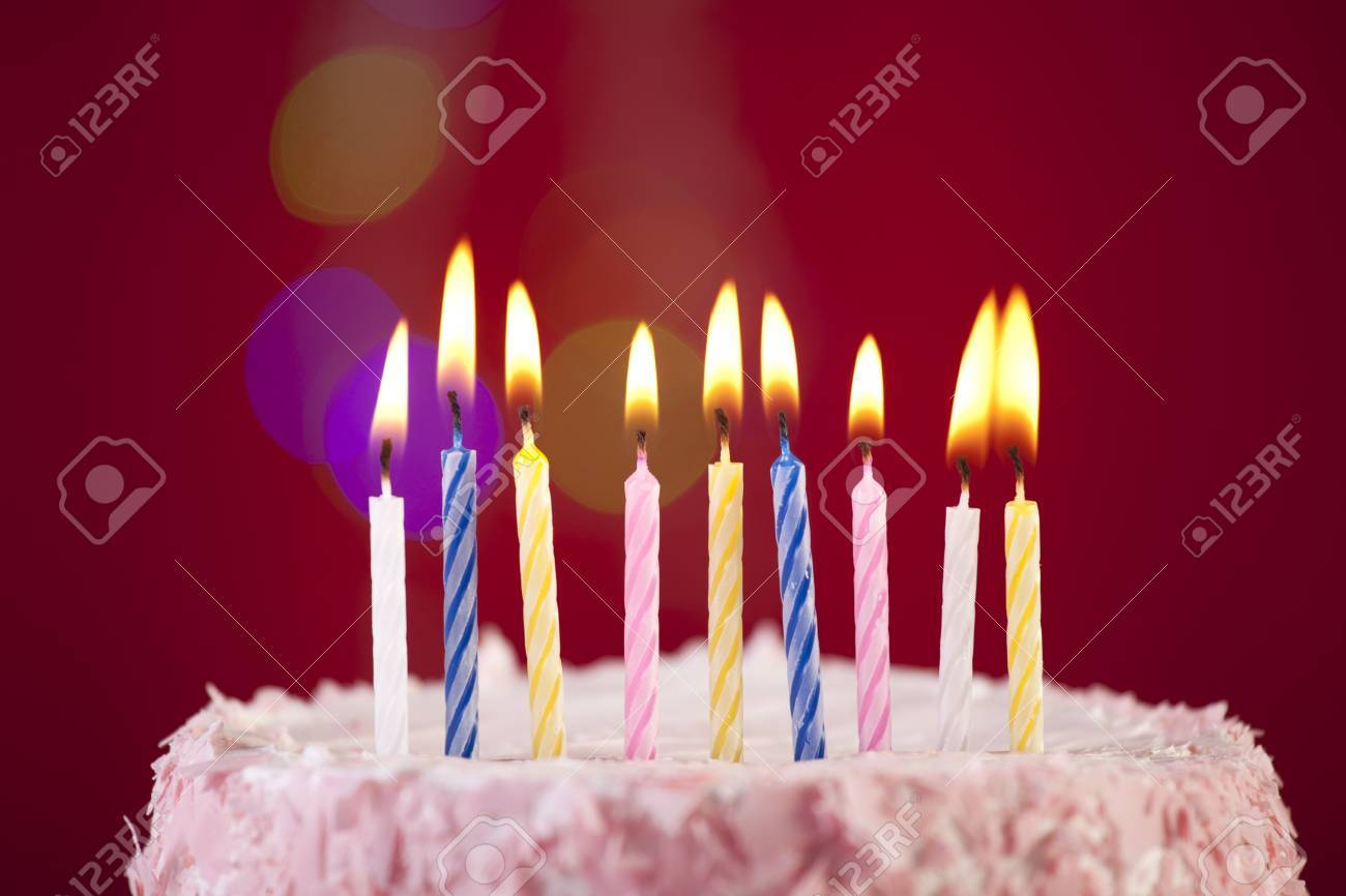 Brilliant Happy Birthday Cake Shot On A Red Background With Candles Stock Funny Birthday Cards Online Fluifree Goldxyz