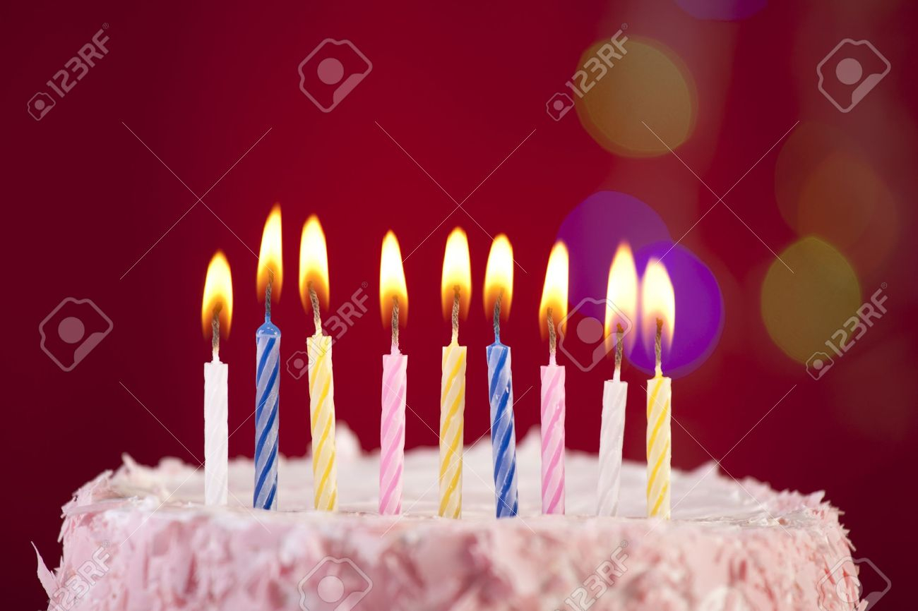 Strange Happy Birthday Cake Shot On A Red Background With Candles Stock Funny Birthday Cards Online Fluifree Goldxyz