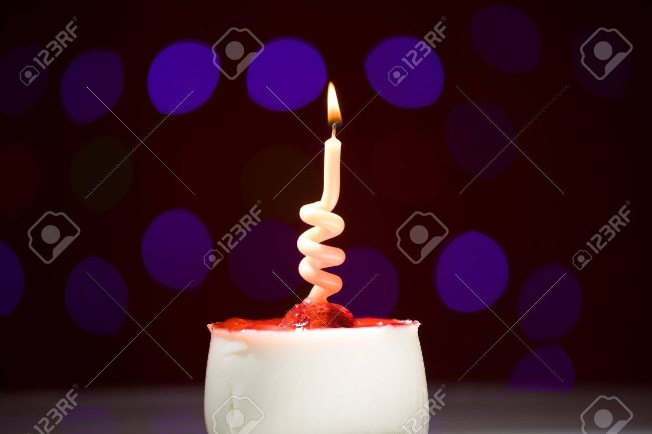 Birthday Cake Shot Images ~ Happy birthday cake shot on a red blurred background with candles