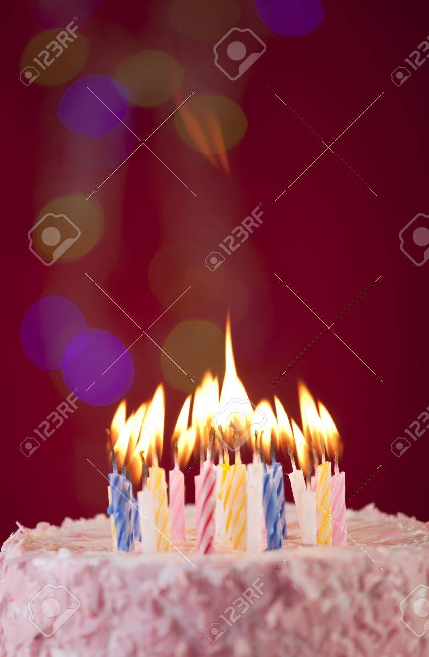 Brilliant Happy Birthday Cake Shot On A Red Background With Candles Stock Personalised Birthday Cards Veneteletsinfo