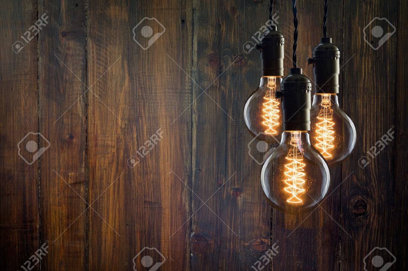 Vintage incandescent Edison type bulbs on wooden wall - 50032493