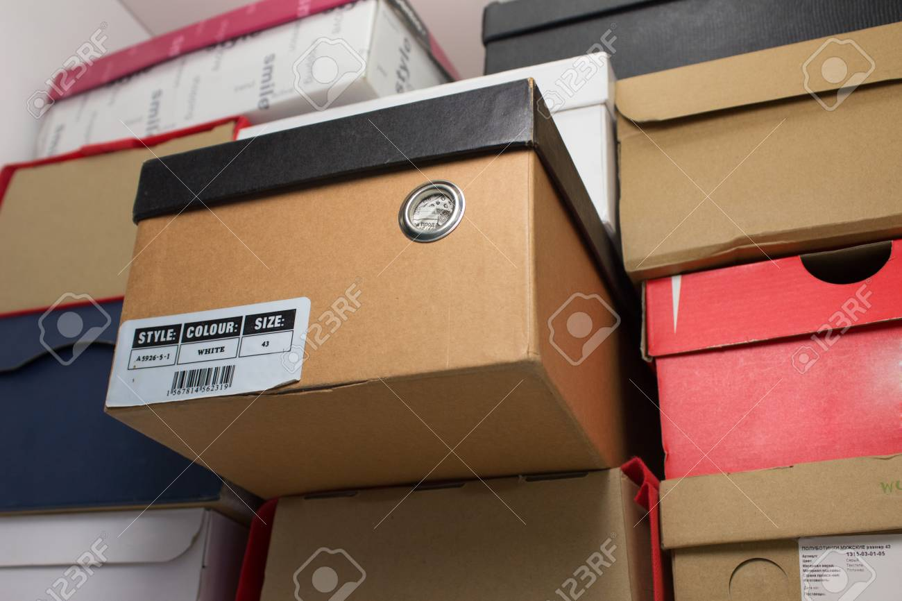 Shoe Box In The Closet On The Shelf. One Of The Boxes Contains Information  About