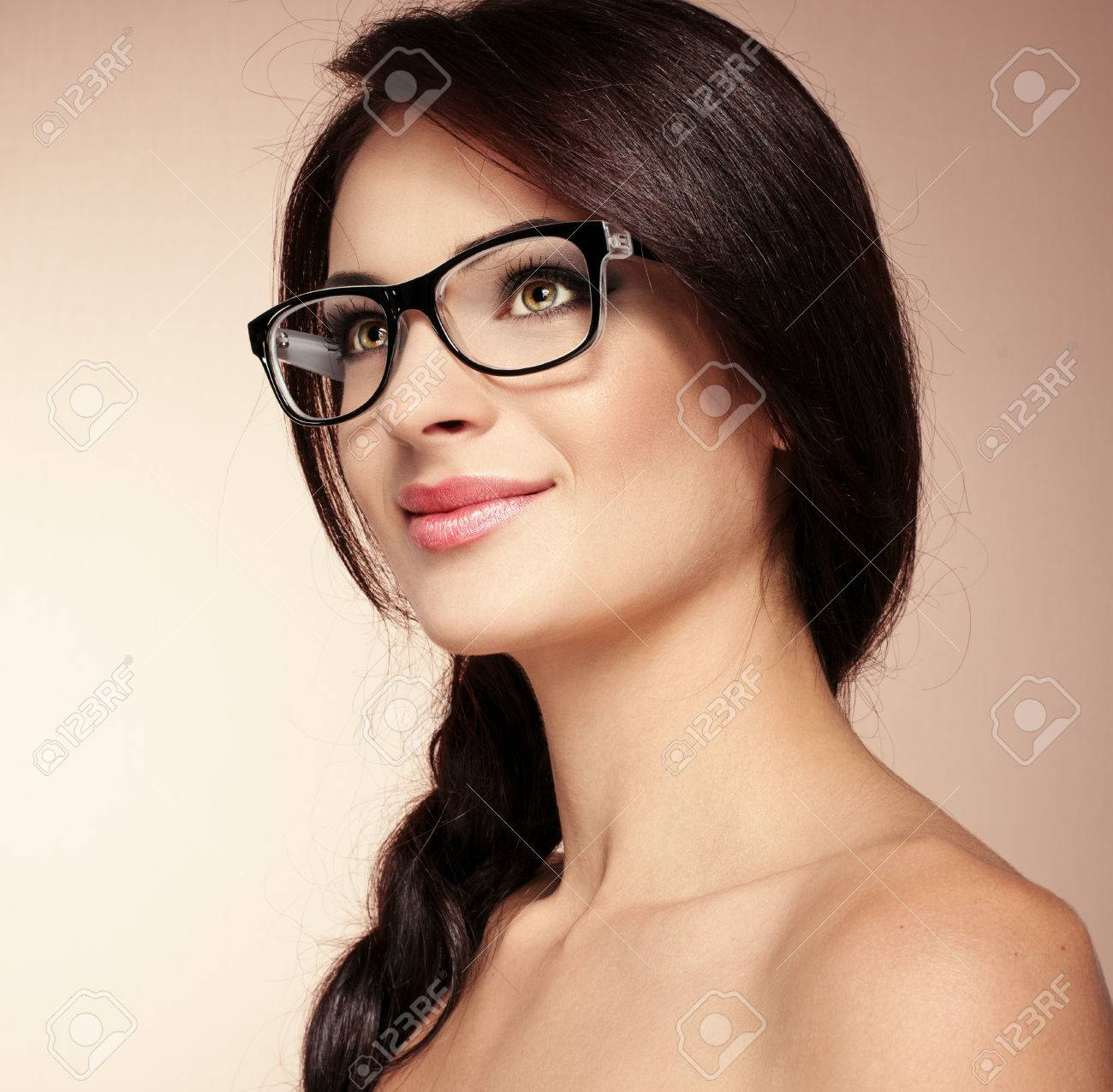e8c5f5a9d0 Portrait of pretty brunette model in fashionable spectacles. Young beautiful  smart lady wearing stylish eyeglasses