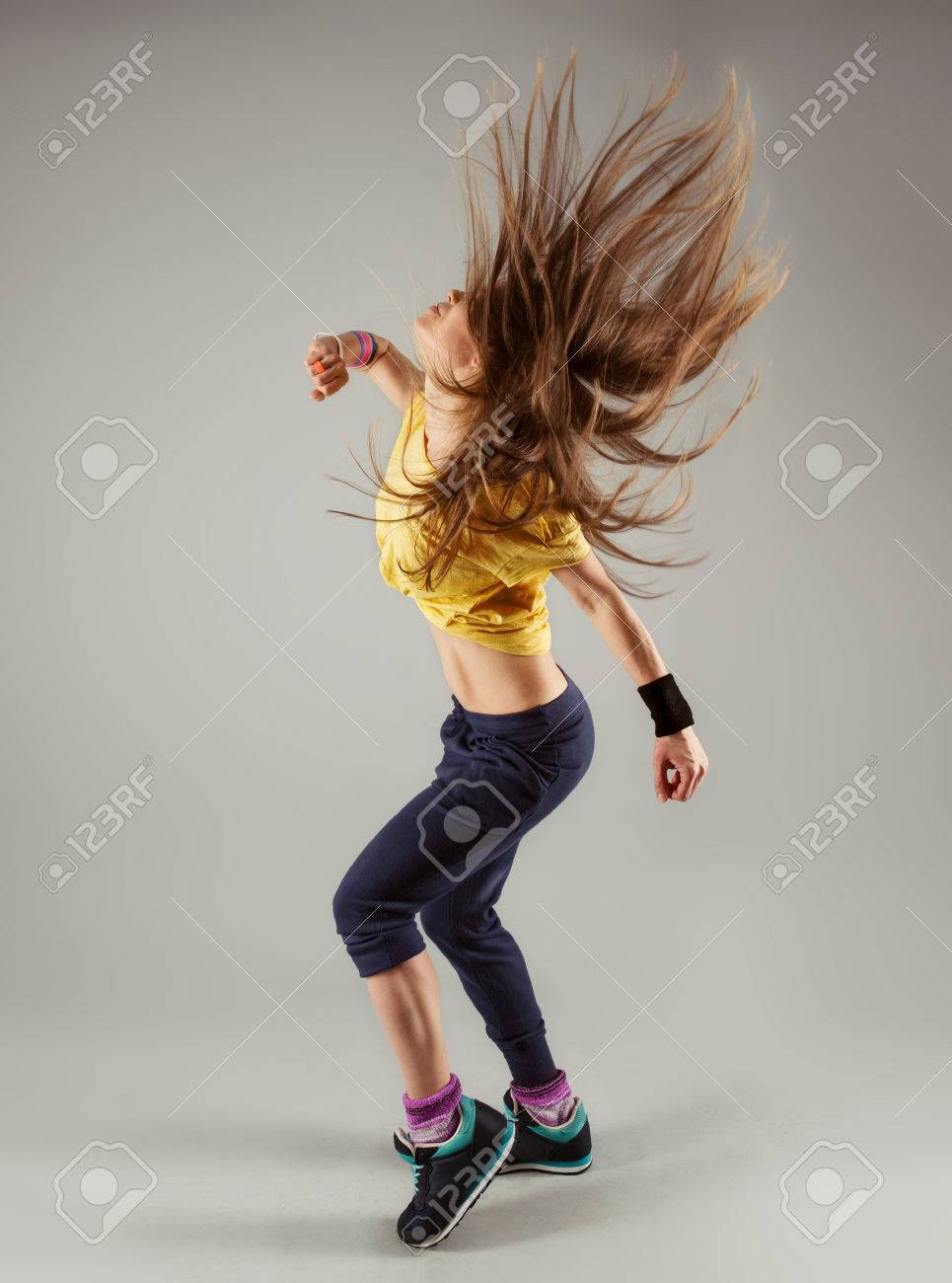 Young energetic fitness woman dancer moving in class. Beautiful slim female performer in motion. - 39330527