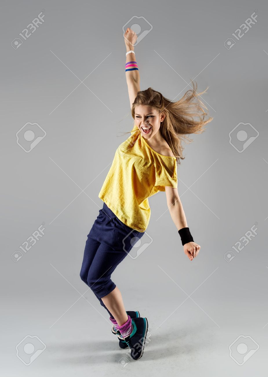 Energetic dancing woman screaming doing dance fitness exercise. Young beautiful jazz girl in motion. - 39304085