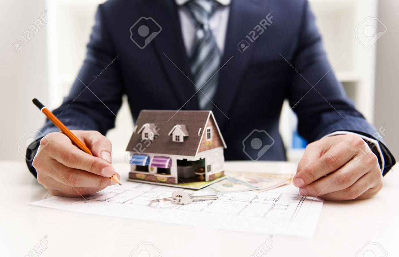 Closeup of male architect drawing heating system plan of customer house in the office. Real estate value and cost concept. Shallow depth of field. - 39619602