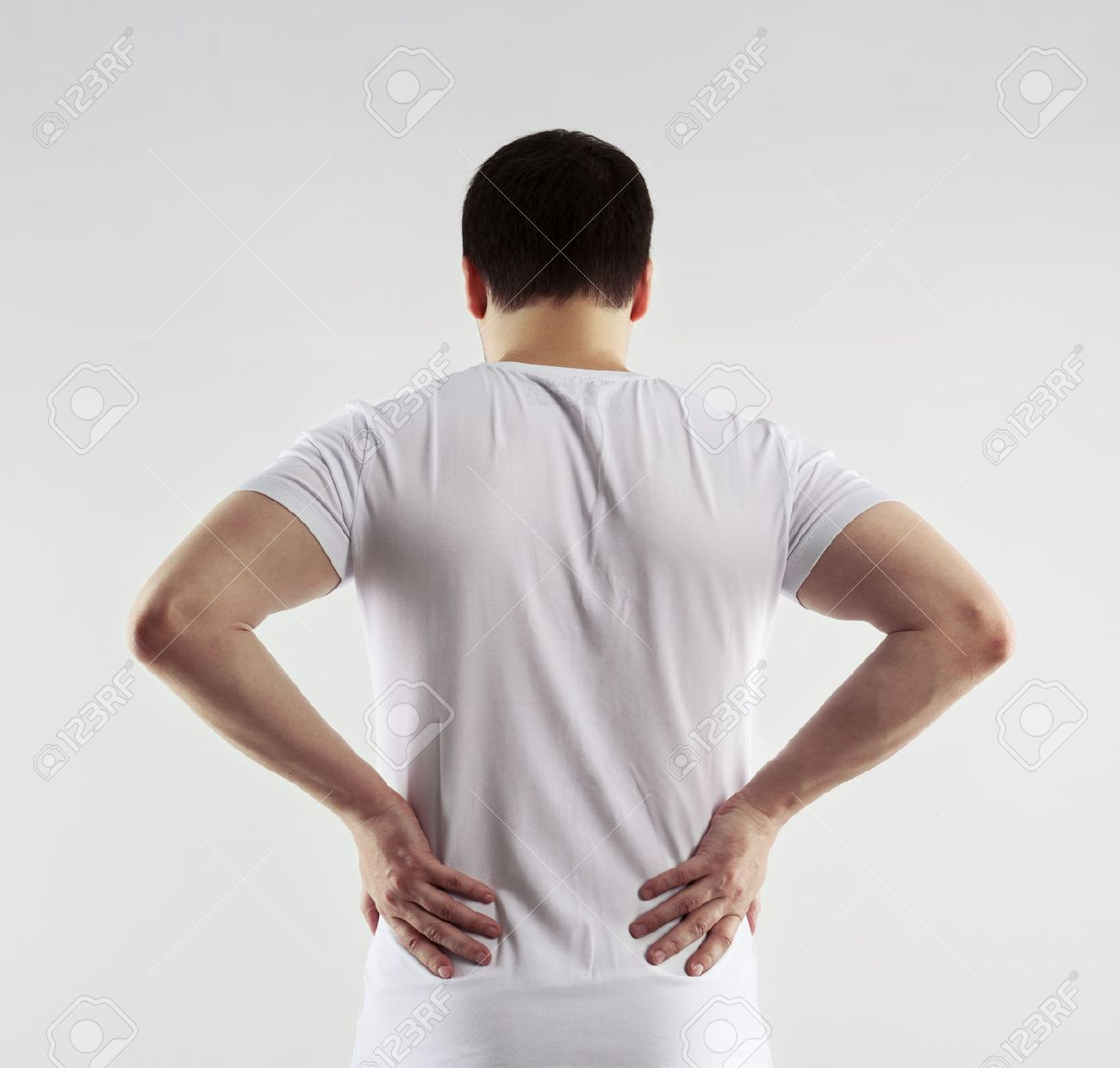 Male painful back and loin. Young man touching his body in pain. Nerve spasm. Chronic ache concept. - 40066555