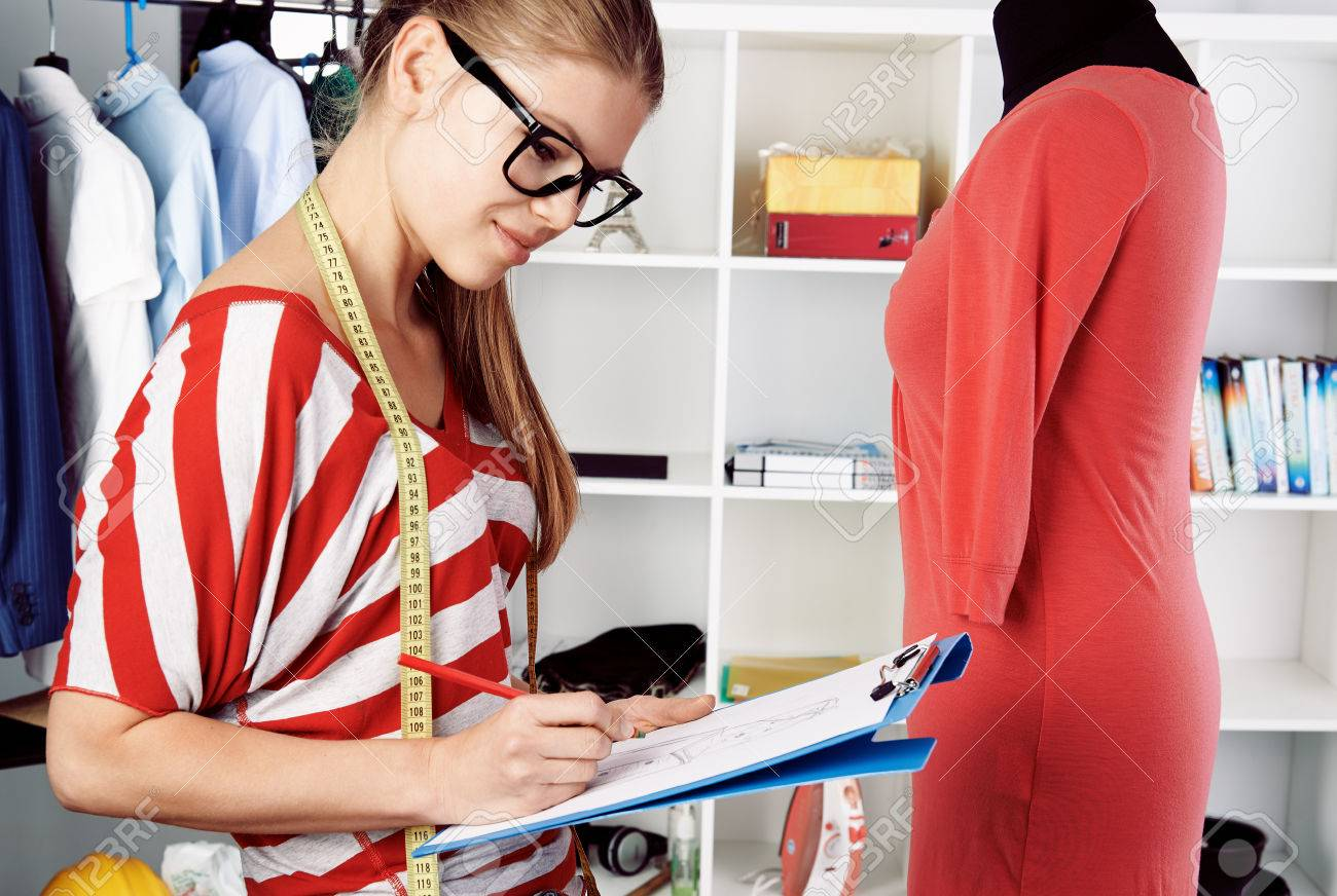 Smiling Woman Entrepreneur Tailor Sketching Near Dummy In Studio Stock Photo Picture And Royalty Free Image Image 41250075