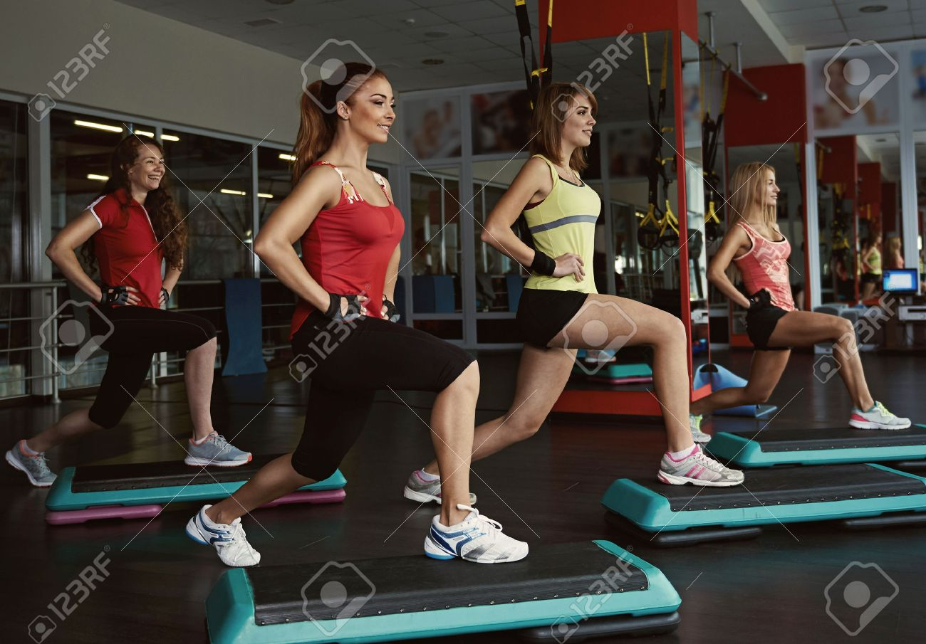 Step course in the gym. Group of female doing aerobics fitness for losing weight. - 55392484