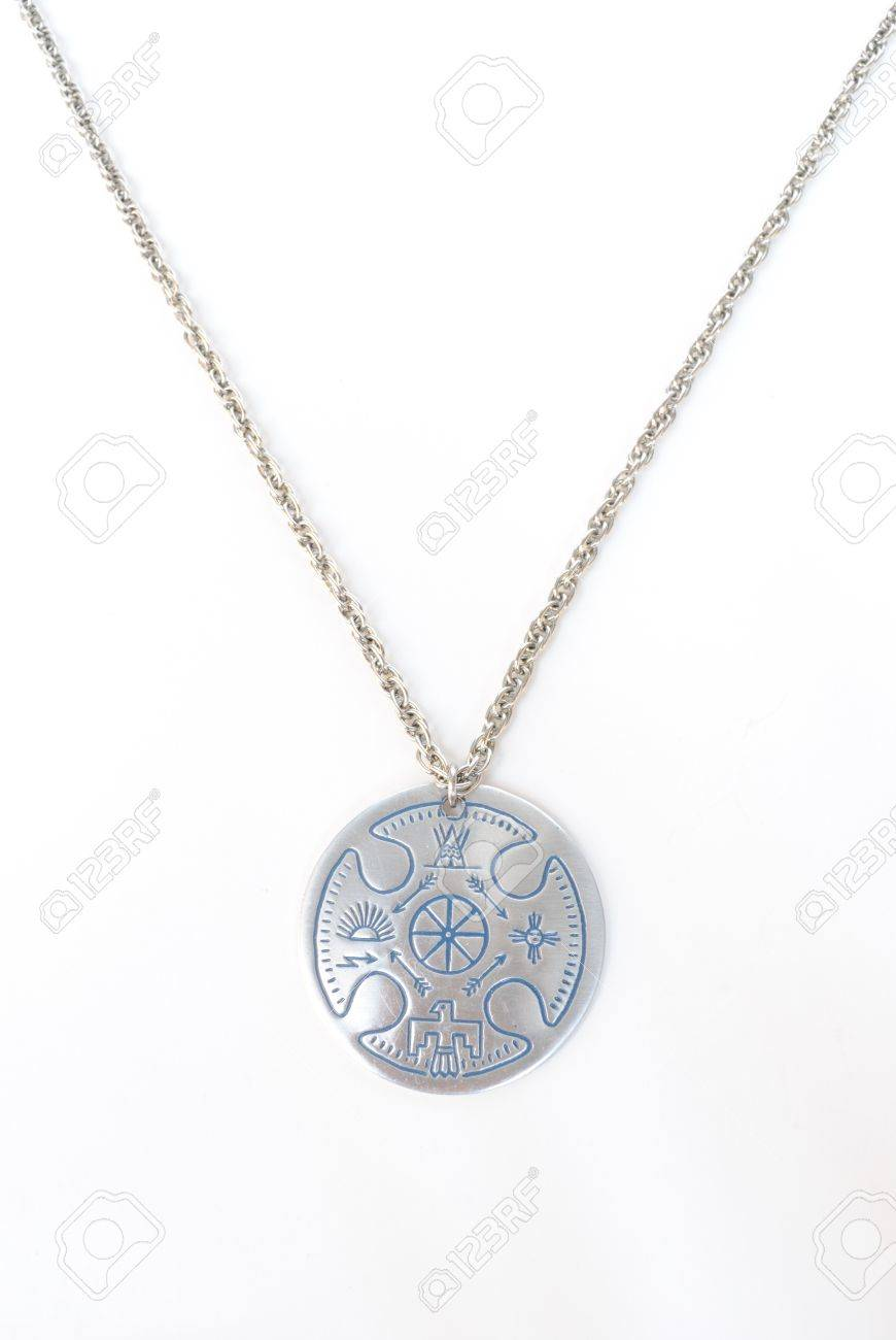 A silver necklace with native american designs. Stock Photo - 7440318
