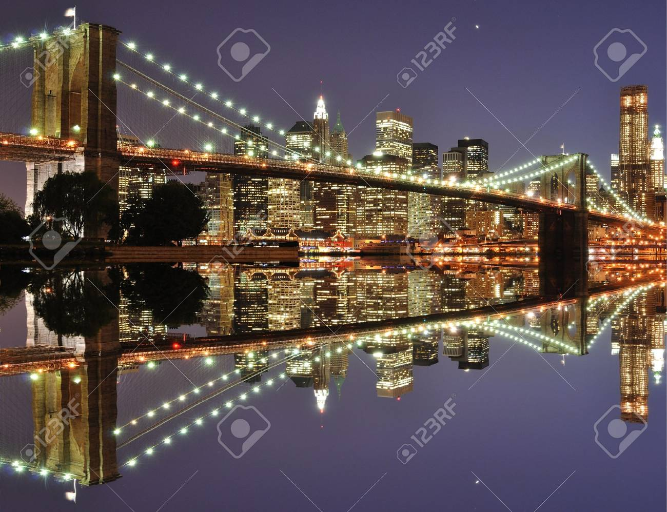 The Lower Manhattan Skyline with serious reflections in New York City. Stock Photo - 8407247