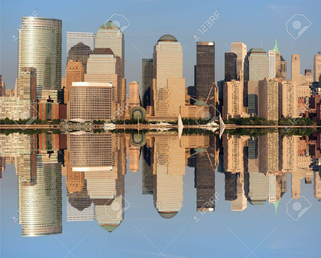The Lower Manhattan Skyline with serious reflections in New York City. Stock Photo - 8407257