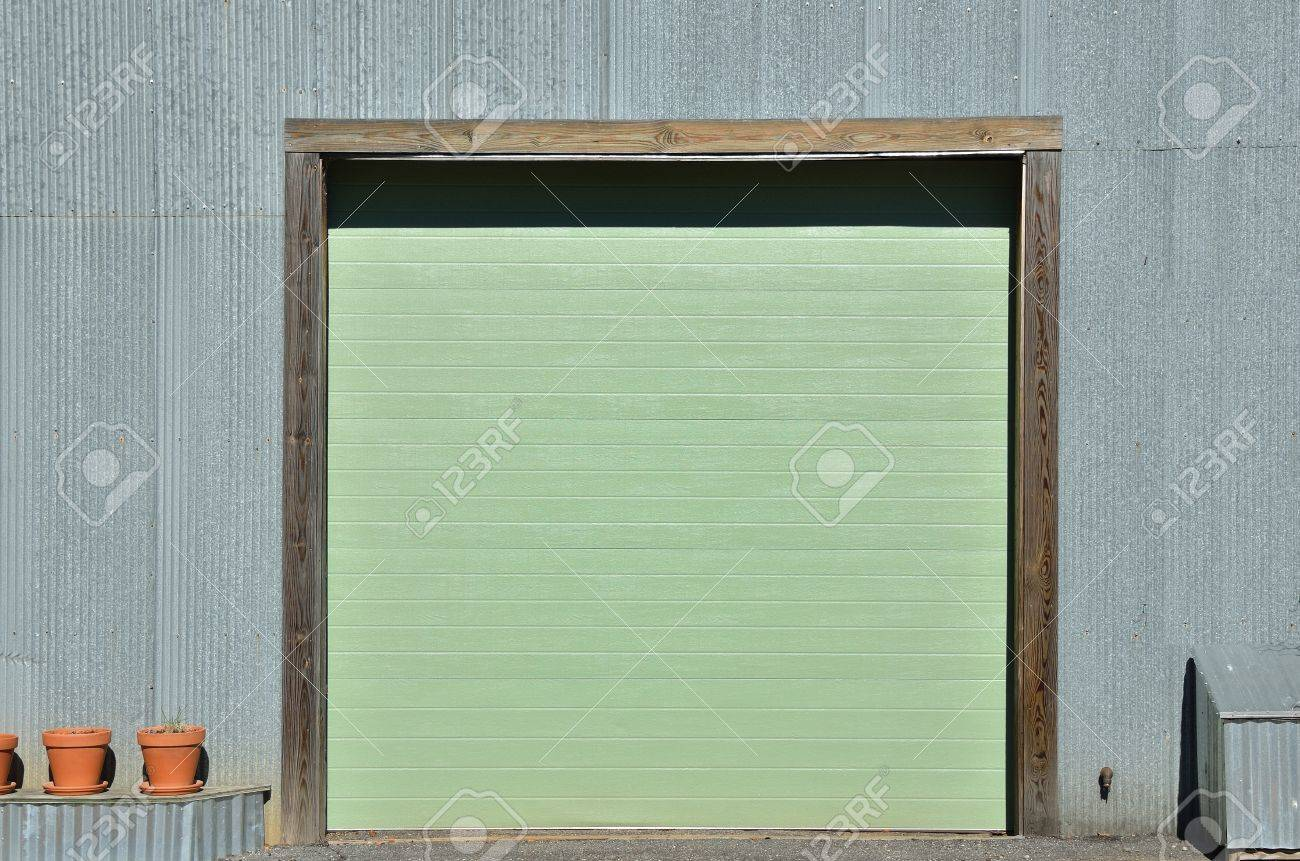 A green garage door at a warehouse. Stock Photo - 9185454