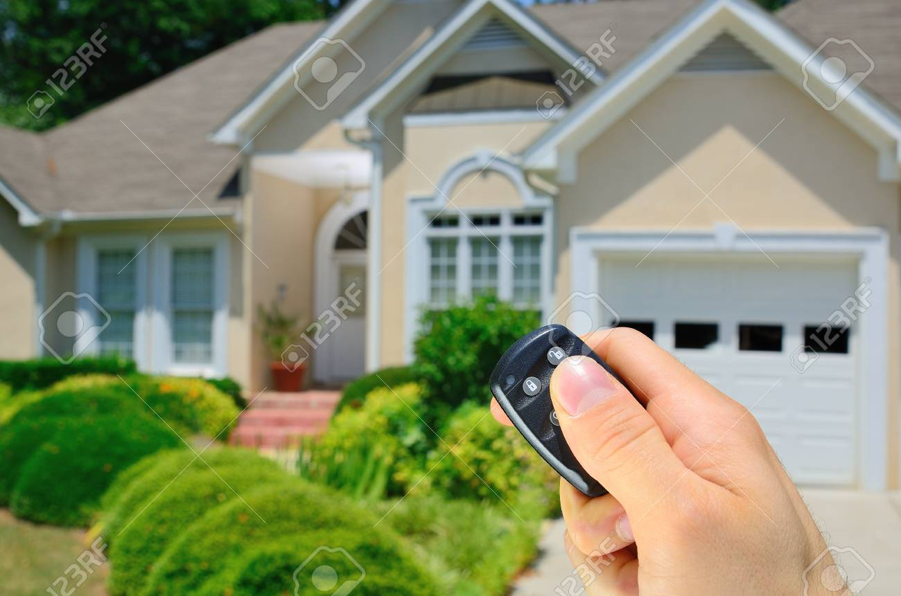 Remote control lock to a home. Stock Photo - 9694300