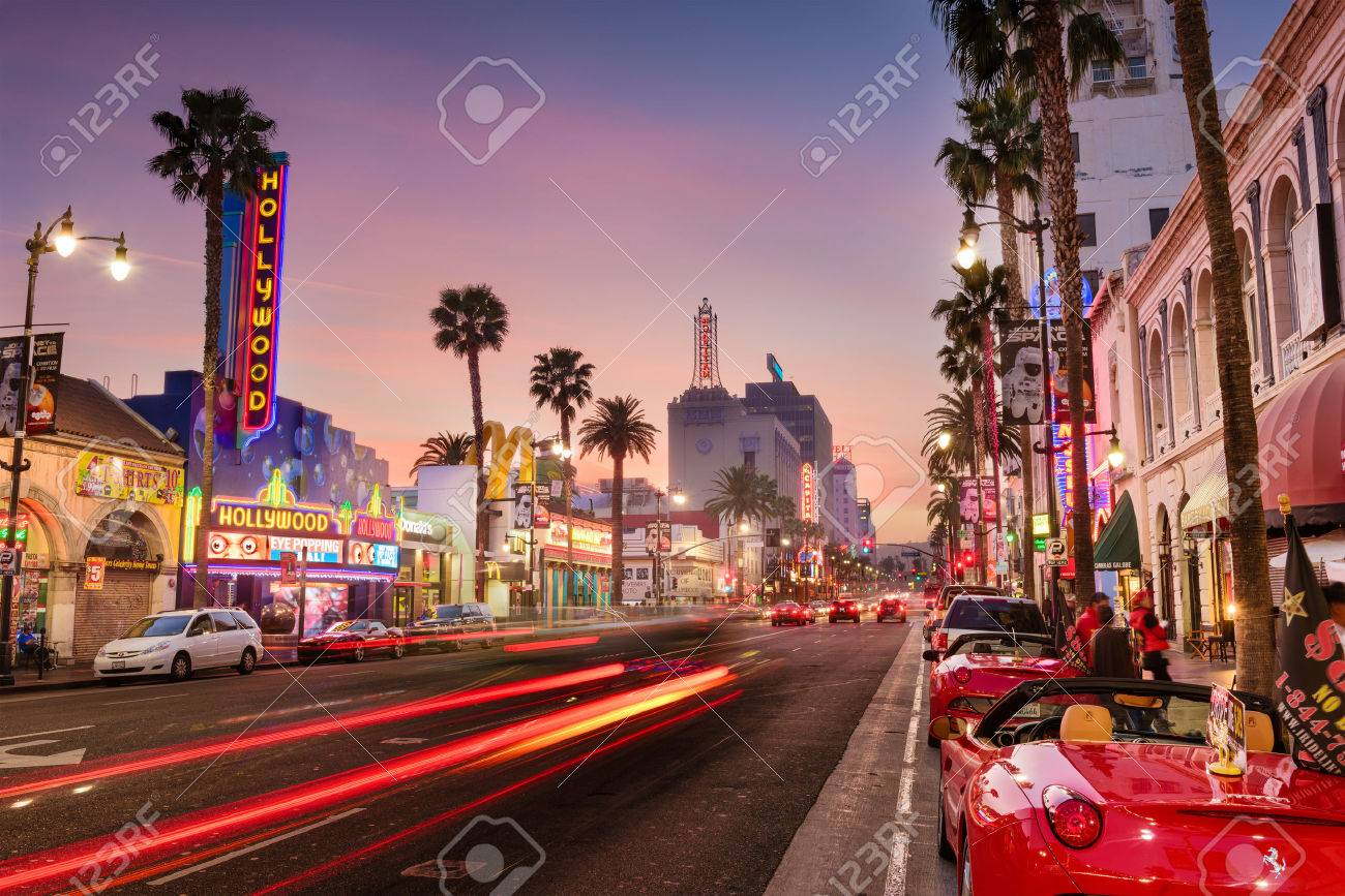 LOS ANGELES, CALIFORNIA - MARCH 1, 2016: Traffic on Hollywood Boulevard at dusk. The theater district is famous tourist attraction. - 54987501